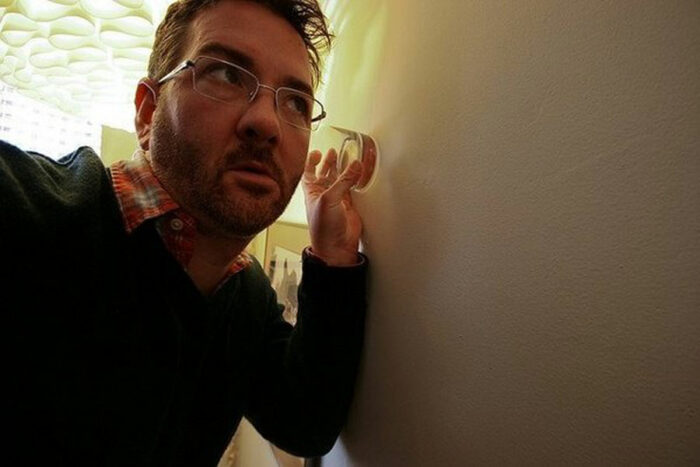 man listening to the walls