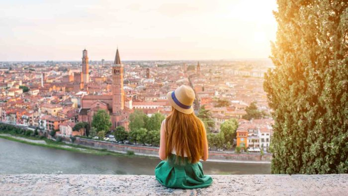 Woman enjoying beautiful view on Verona city