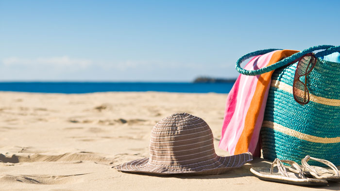 picture of a sun-hat, slippers and beach bag