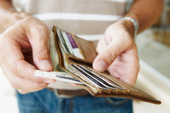 man pulling cash from his wallet